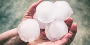 person holding large balls of hail
