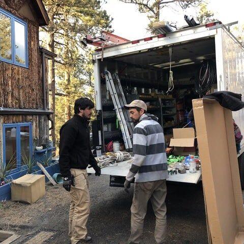 John & Patty Solar Installation in Evergreen, CO - Sean and Noah unloading the truck